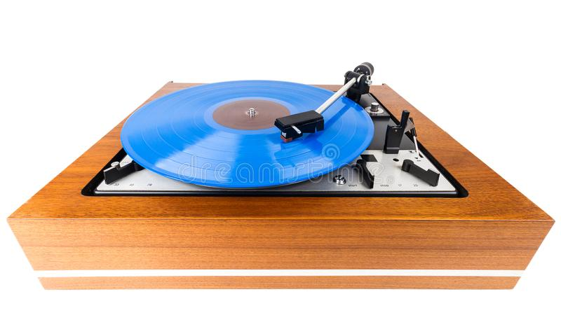 Vintage turntable with a blue vinyl isolated on white. Wooden plinth. Retro audio equipment stock images