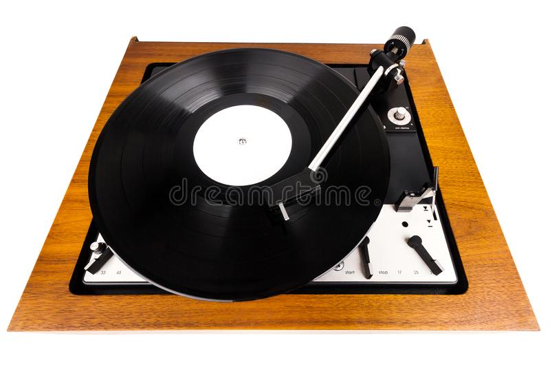 Vintage turntable vinyl record player isolated on white. Wooden plinth. Retro audio equipment royalty free stock photo