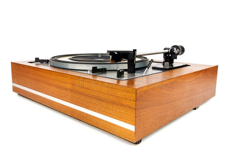 Vintage turntable vinyl record player isolated on white. Wooden plinth. Retro audio equipment stock photo