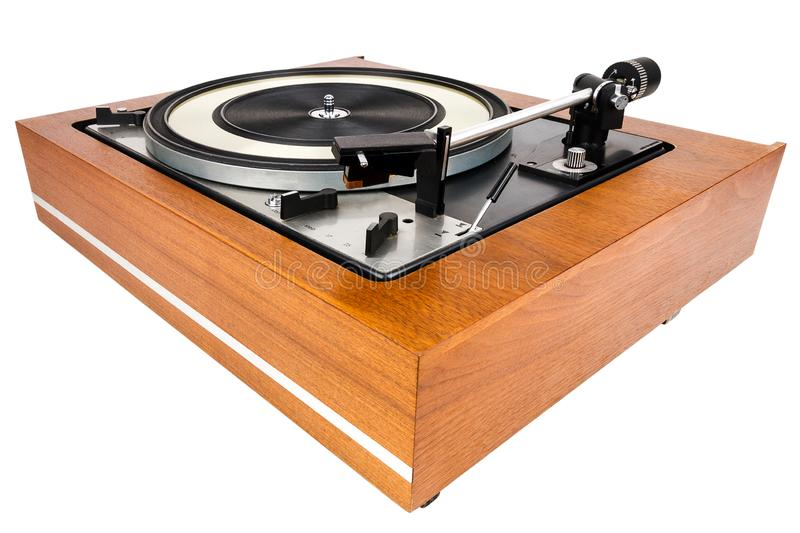 Vintage turntable vinyl record player isolated on white. Wooden plinth. Retro audio equipment stock image