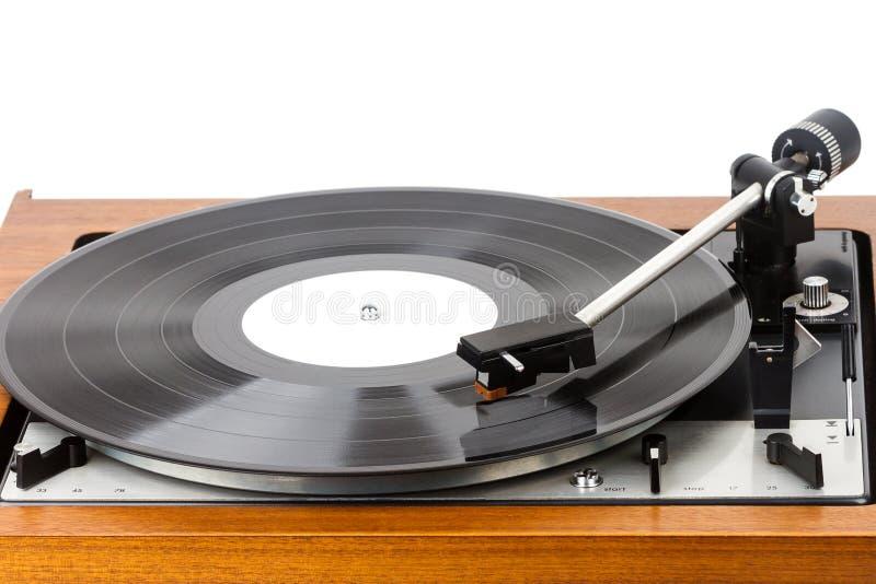 Vintage turntable vinyl record player  on white. Wooden plinth. Retro audio equipment stock photos