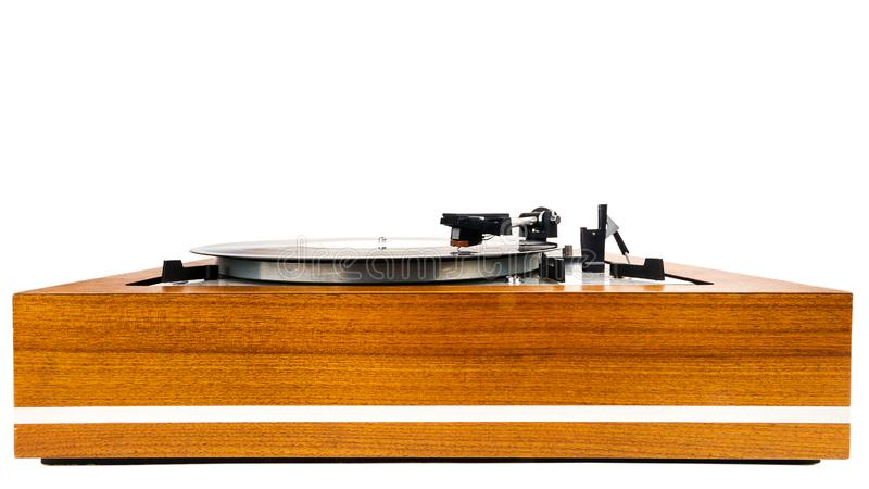 Vintage turntable vinyl record player isolated on white. Wooden plinth. Retro audio equipment royalty free stock photography