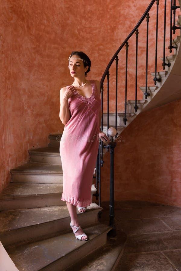 Vintage twenties woman on stairs stock images