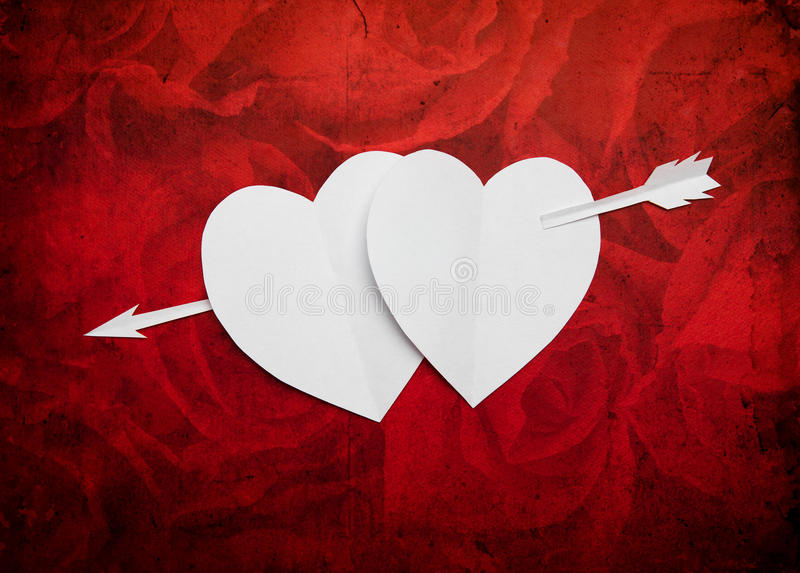 Vintage two paper hearts pierced with an arrow symbol for Valentines day with copy space for text or design stock photos