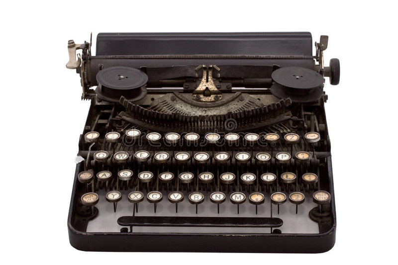 Vintage typewriter. Front view of a vintage typewriter on an isolated white background royalty free stock image
