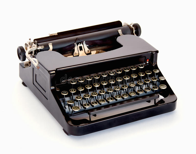 Vintage Typewriter. Vintage 1940 black typewriter on white background stock image