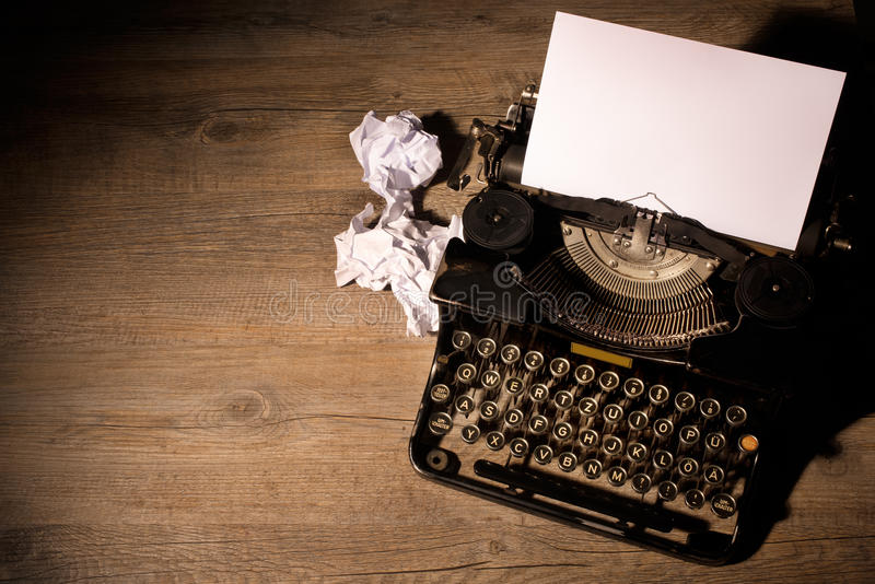 Vintage typewriter. And a blank sheet of paper royalty free stock photos