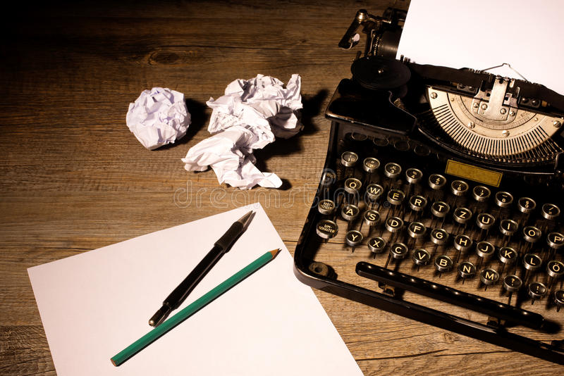 Vintage typewriter. And a blank sheet of paper royalty free stock images