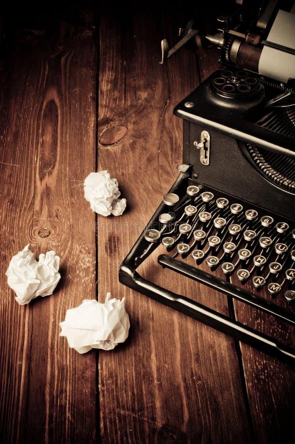 Vintage typewriter and a blank sheet of paper. Retouching retro royalty free stock image