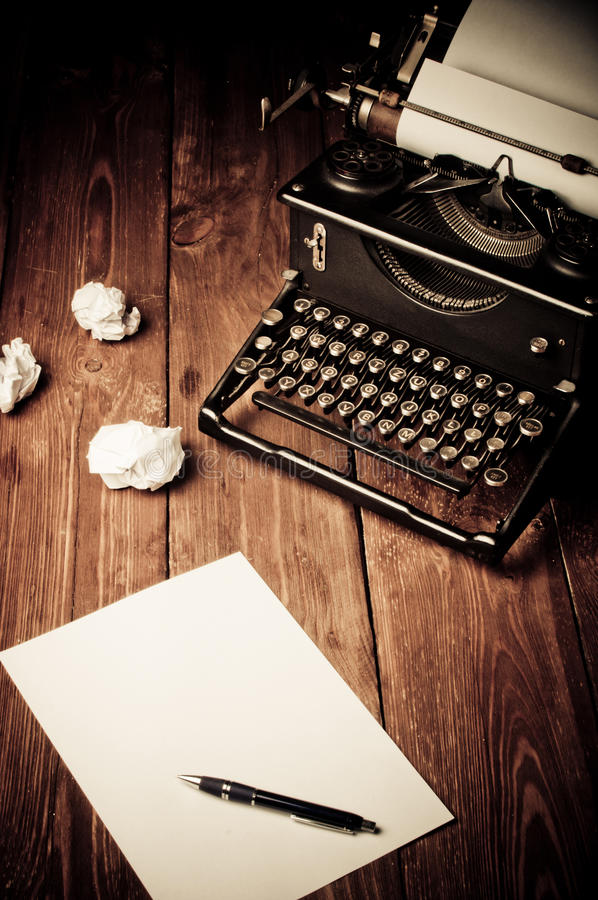 Vintage typewriter and a blank sheet of paper. Retouching retro royalty free stock images