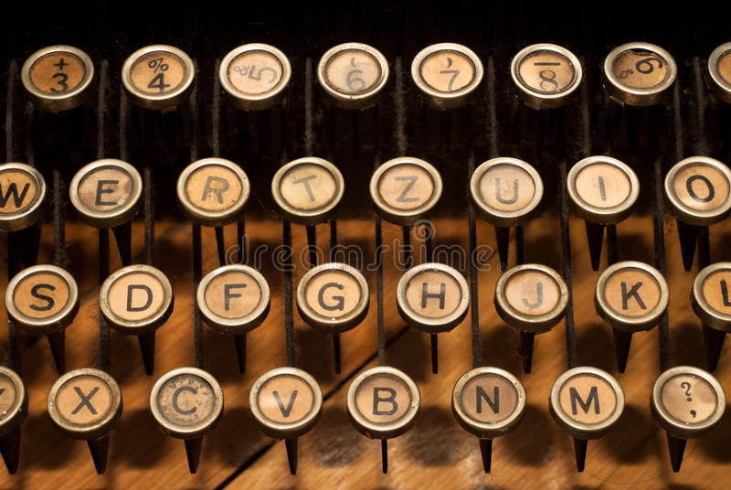 Vintage typewriter. Closeup of retro, old-fashioned typewriter keyboard royalty free stock images