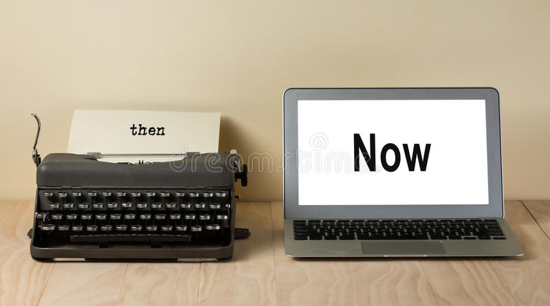 Vintage typewriter and computer laptop. With words now and then stock images