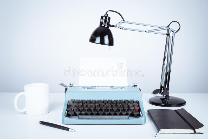 Vintage typewriter. And desk with lamp royalty free stock photo