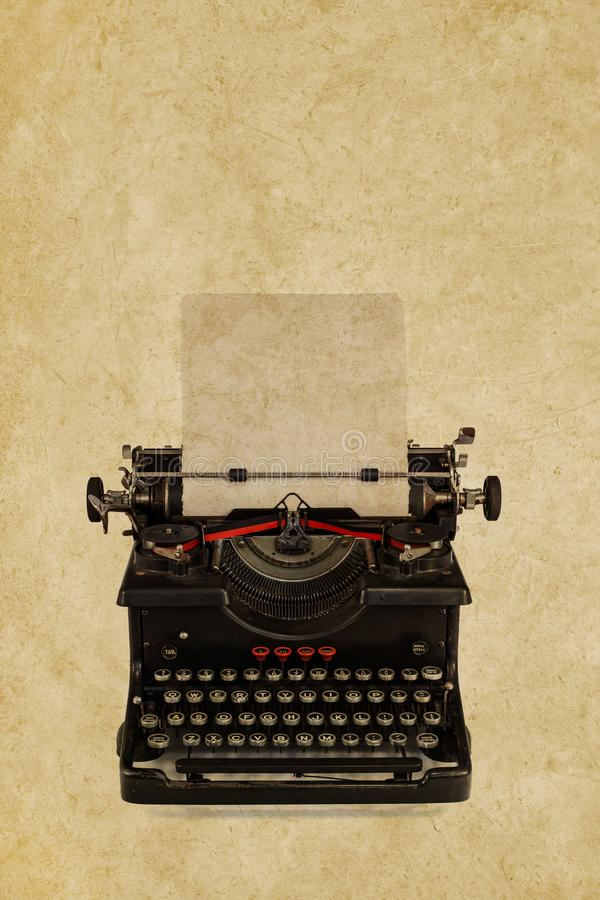 Vintage typewriter in front of a sepia background stock image