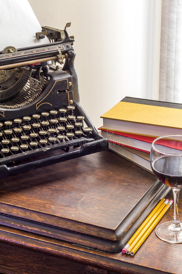 Vintage Typewriter Glass of Wine. Old vintage typewriter with glass of wine pencils and books in this retro creative writing and relazation themed desk top stock images