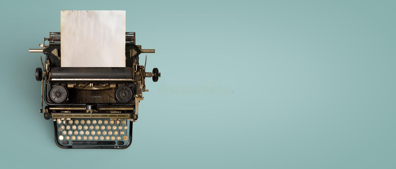 Vintage typewriter header with old paper stock image