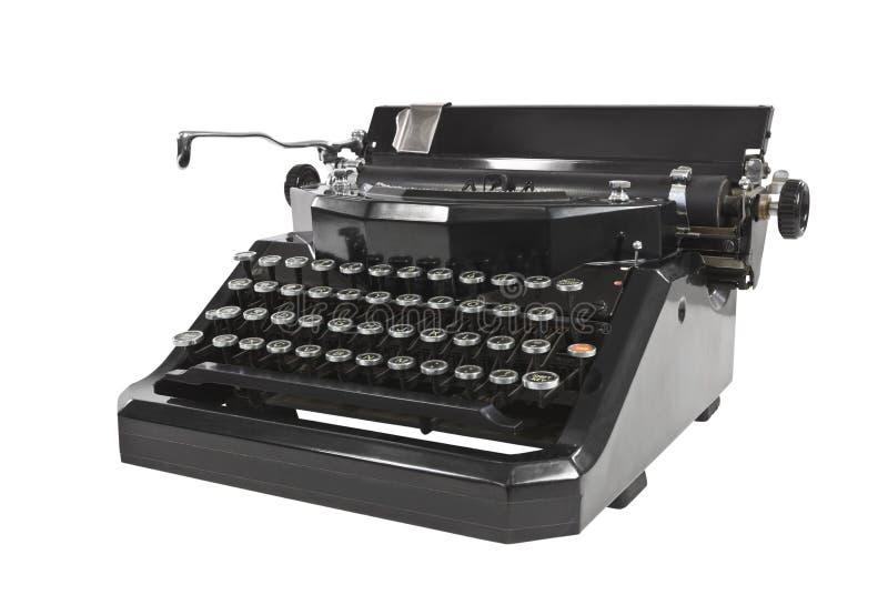 Vintage Typewriter Isolated. Vintage black typewriter isolated on white royalty free stock images