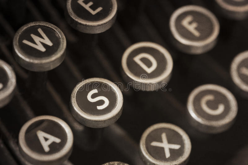 Vintage Typewriter Keys with Grunge Effects royalty free stock photography