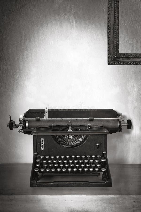 Vintage Typewriter on Old Desk with Grunge Background stock images