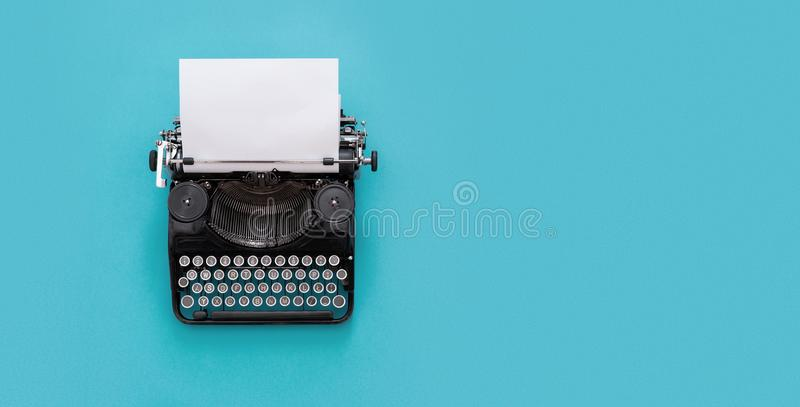 Vintage typewriter. Over blue background with copy space stock photo