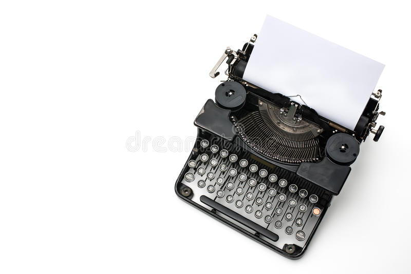 Vintage typewriter. With paper sheet isolated on white stock photography