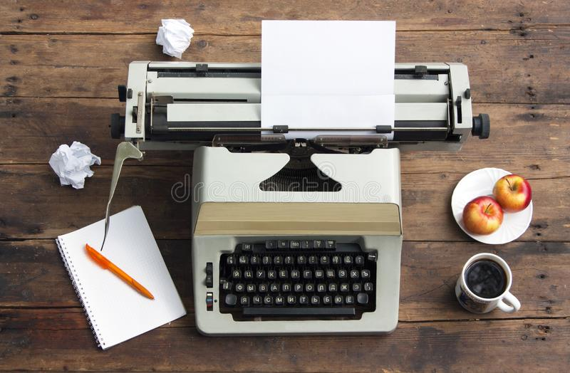 Vintage typewriter with a sheet of paper on an old desk. Writer Workplace stock images