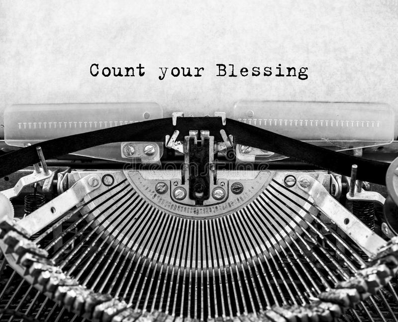 Vintage typewriter with text Count your Blessing. stock photo