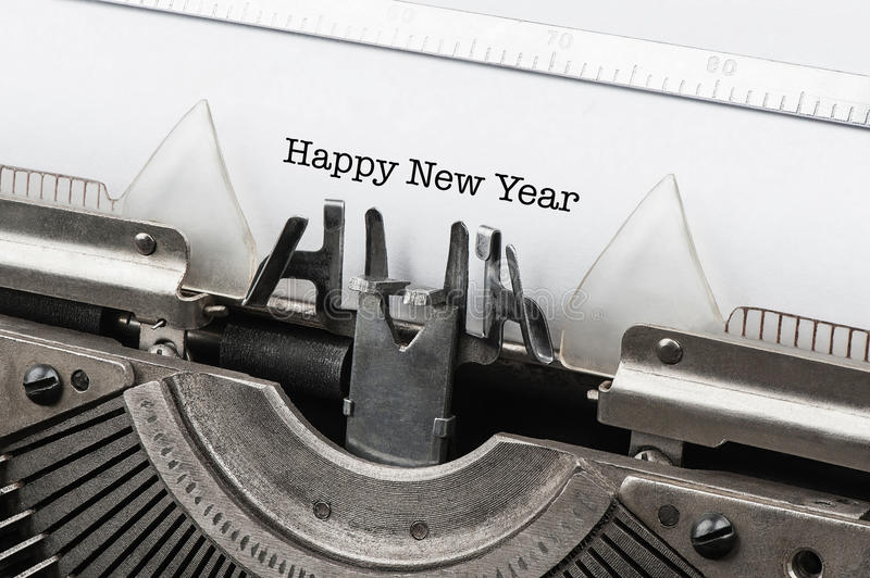 Vintage typewriter with text happy new year. Old vintage typewriter with text happy new year stock photography