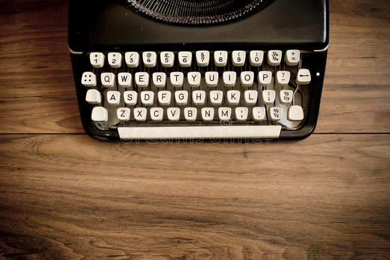 Vintage Typewriter. A Vintage Typewriter on a wooden table stock photos