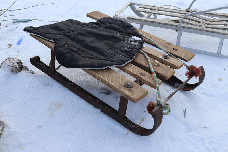 Vintage Ukrainian sled from iron and wood on the snow. Winter rest. Having fun outdoors royalty free stock photography