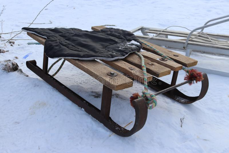 Vintage Ukrainian sled from iron and wood on the snow. Winter rest. Having fun outdoors stock photos