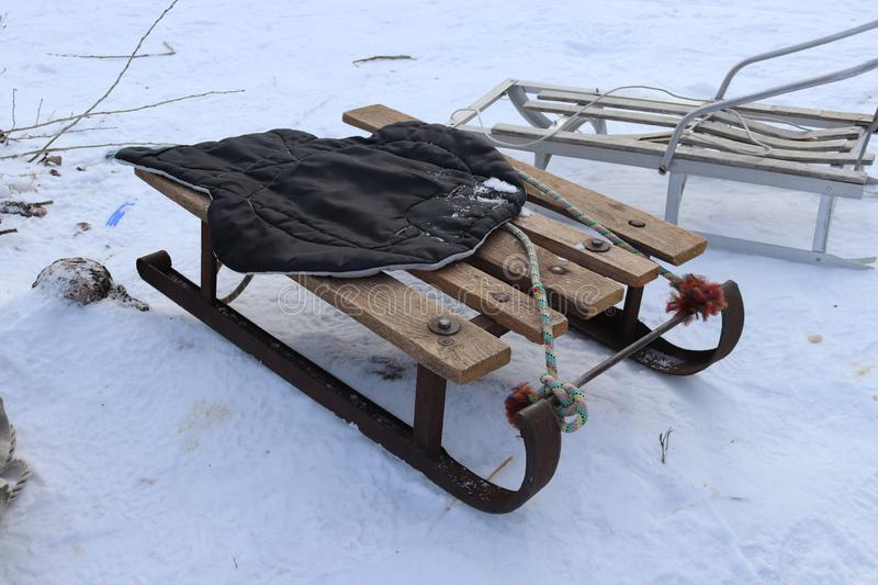 Vintage Ukrainian sled from iron and wood on the snow. Winter rest. Having fun outdoors stock photo