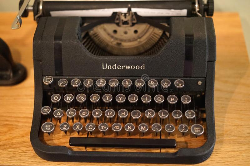 Vintage Underwood manual typewriter. Besides meeting deadlines and writing books, old manual typewriters are used in home and business decor to add a vintage stock image