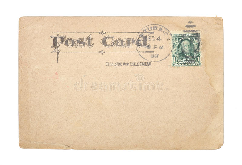 Vintage United States 1907 Postcard. A blank, vintage United States postcard from 1907 with a green, cancelled, one-cent stamp. Post card shows water stains and royalty free stock photos