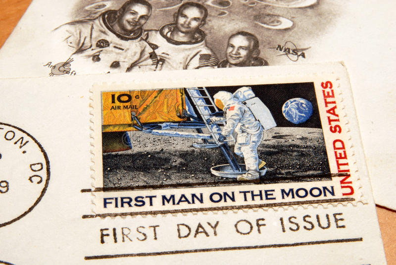 Vintage US stamp of the first man on the moon. Close up of a postcard with the stamp commemorating the first man on the moon stock photo