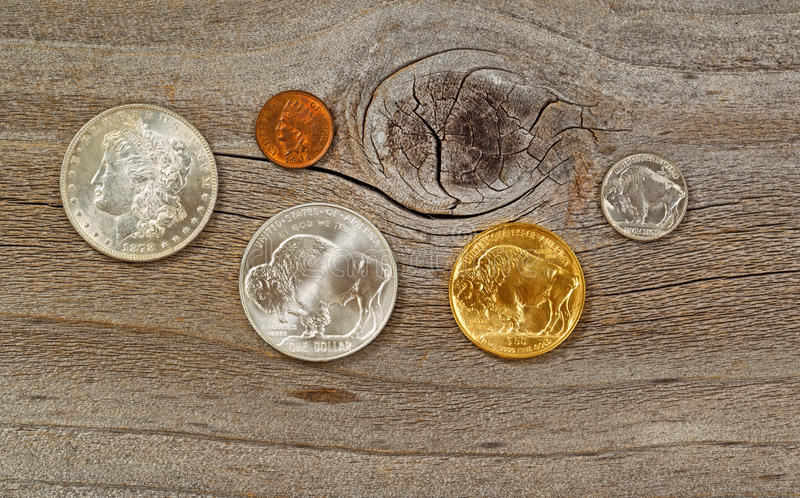 Vintage USA Coins on weathered wood. United States Mint issued American vintage coins, consisting of silver, gold and nickel metals, on rustic wood stock image