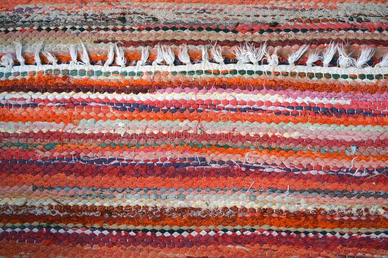 Vintage used knitted handmade carpet background. Vintage used knitted handmade carpet colorful background and texture royalty free stock photo