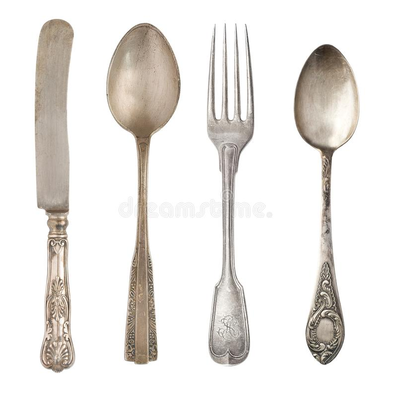 Vintage usou facas e garfos isolados em fundo branco Silverware retroativo imagens de stock