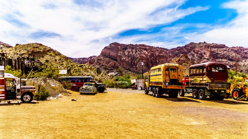 Vintage vehicles in the old mining town of El Dorado in the Eldorado Canyon in NV. Vintage vehicles used in several old movies are still on display in the old royalty free stock images