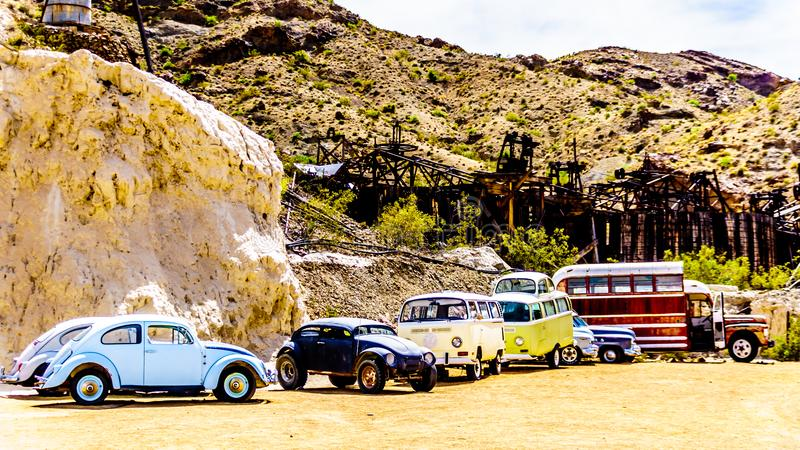 Vintage vehicles in the old mining town of El Dorado in the Eldorado Canyon in NV. Vintage vehicles used in several old movies are still on display in the old royalty free stock image