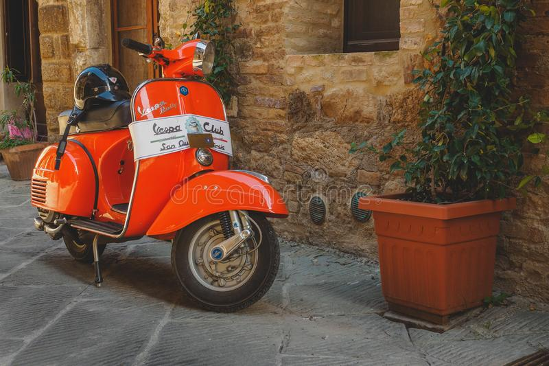 Vintage Vespa Piaggio parked in a street of a Tuscan town. Italy, 2017 royalty free stock image