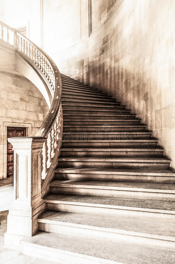Vintage view of marble spiral staircase. royalty free stock photography