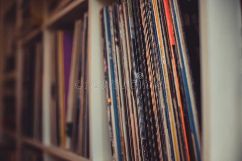 Vintage 33 vinyl long playing row on shelf. Selective focus royalty free stock photo