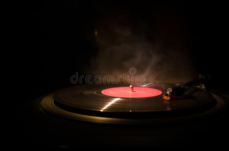 Vintage vinyl record playing on player and acoustic guitar on background with fire orange smoke. Blues concept. With Toy car stock images