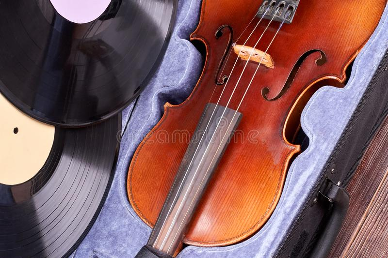 Vintage violin and vinyl records. stock photo