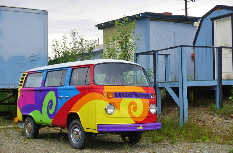 A vintage Volkswagen (VW) camper van painted with psychedelic hippy colors. ANCHORAGE, AK - A vintage Volkswagen (VW) camper van painted with psychedelic hippy royalty free stock images