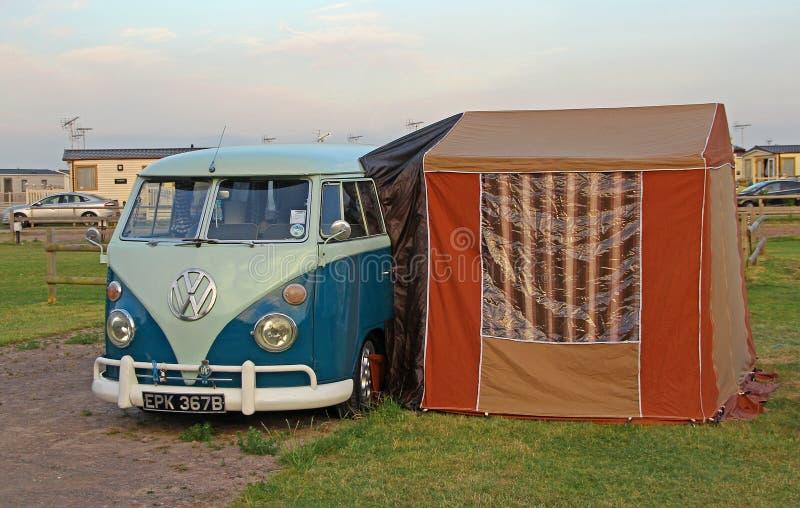Vintage volkswagon splitscreen camper van. Photo of a vintage vw split screen camper van with attached awning on campsite whitstable kent. photo taken 19th june stock photos