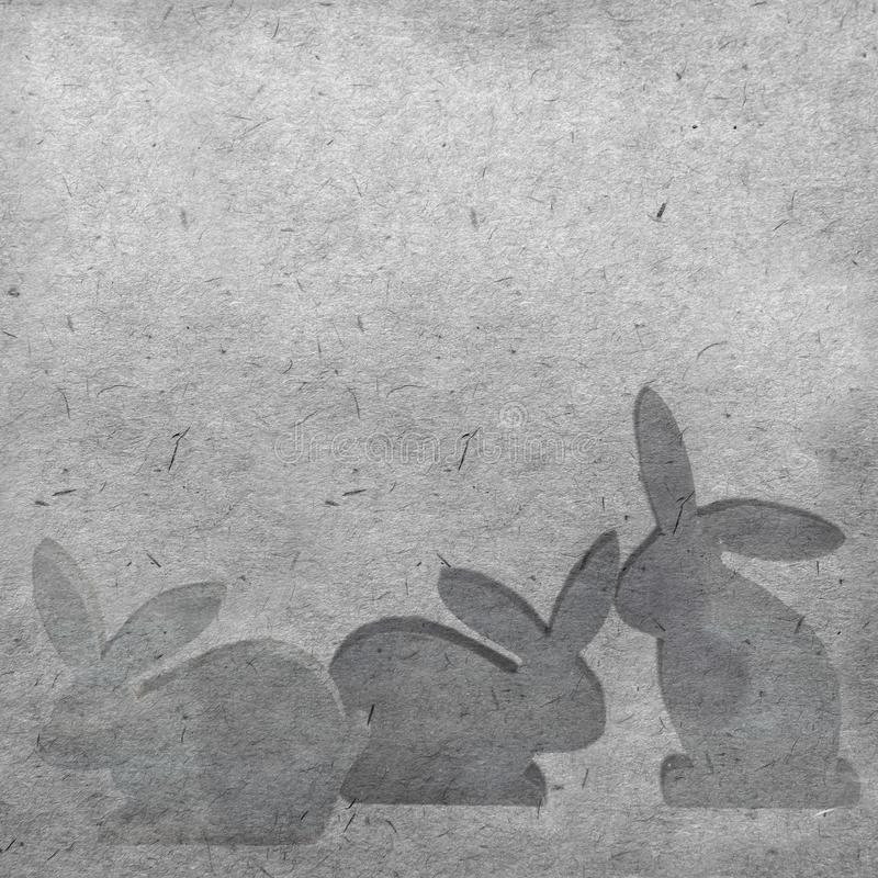 Silhouettes of easter hares on a vintage background. royalty free stock photo