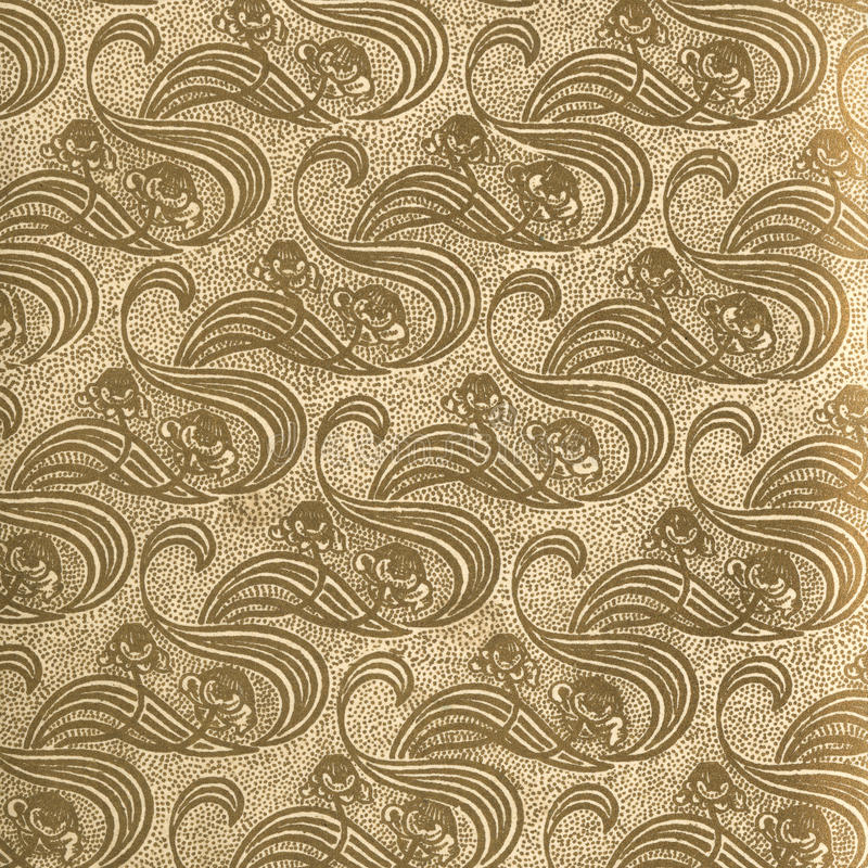 Vintage wallpaper Gold. Used vintage wallpaper in gold with floral curls, natural grainy surface royalty free stock image