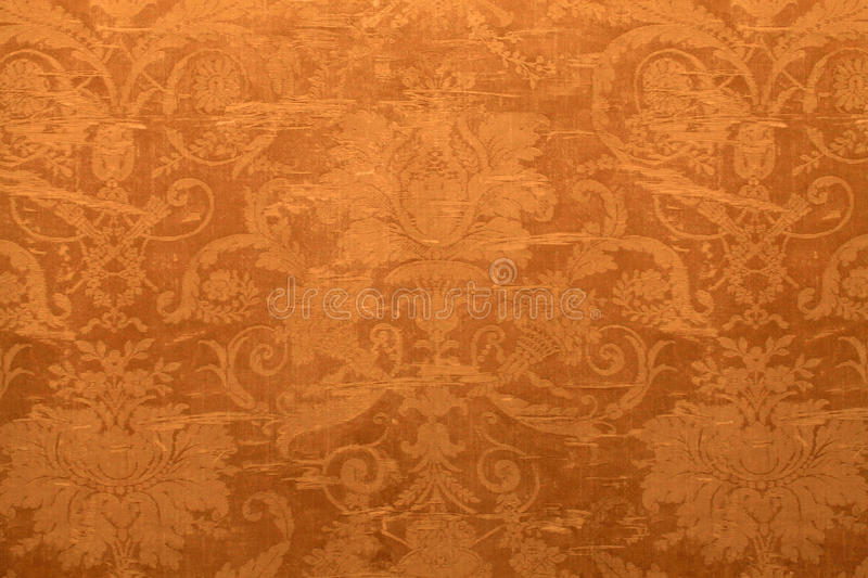 Vintage wallpaper with shabby tapestry pattern. Vintage golden wallpaper with shabby tapestry victorian pattern stock photography